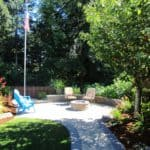 Area has been transformed into a desirable destination spot with large paver patio, fire pit , seating wall and surrounded by lush plantings